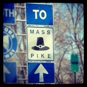Massachusetts Turn Pike Sign is a Pilgrim Hat.