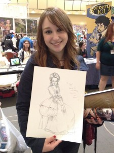 Cody shows off her commission.