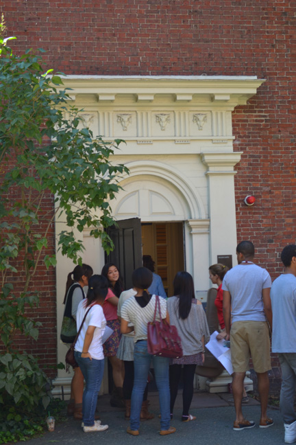 students outside of Holden Chapel's doorway