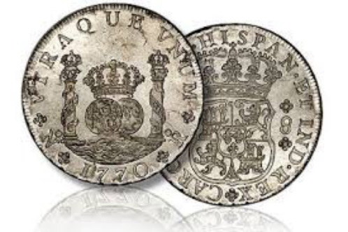 A silver Spanish milled or pillar dollar, a standard in international trade of the 18th century:
